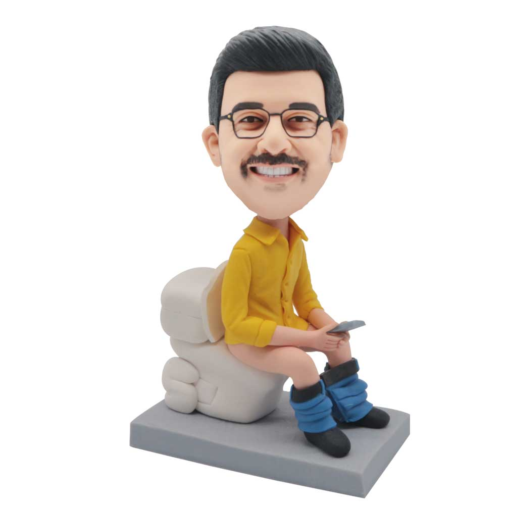 Custom-Funny-Male-Bobblehead-In-Yellow-Shirt-On-The-Toilet