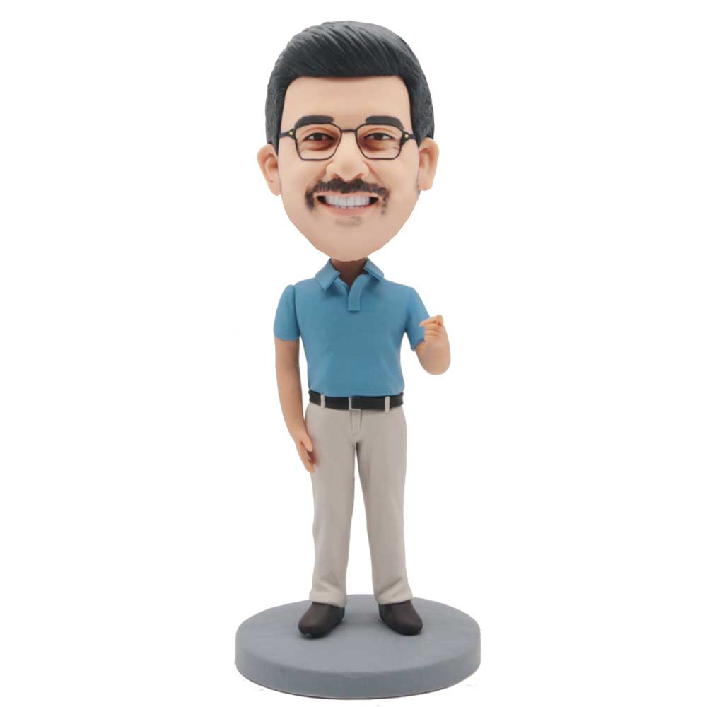 Custom-Male-Leisure-Bobblehead-In-A-Blue-Shirt-And-One-Finger-Pointing-Forward