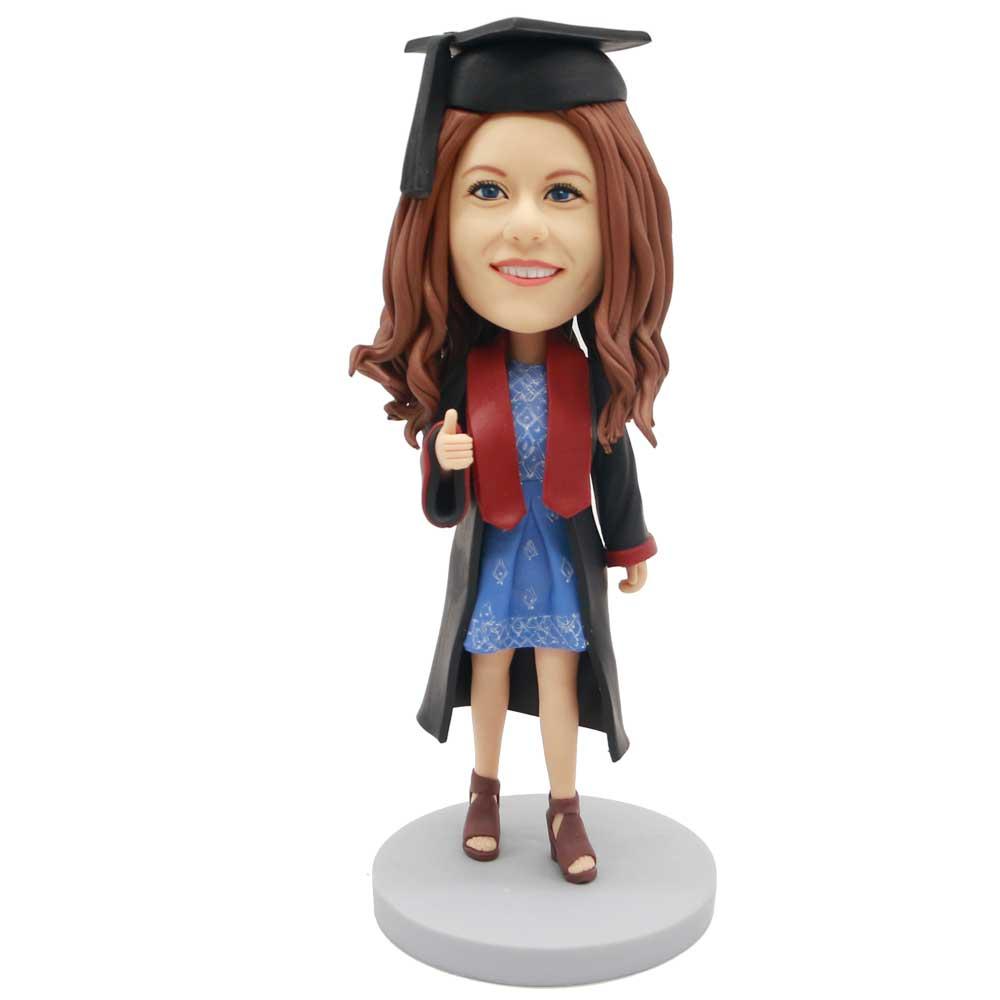 Custom-Female-Graduation-Bobblehead-In-Black-Gown-And-Blue-Dress