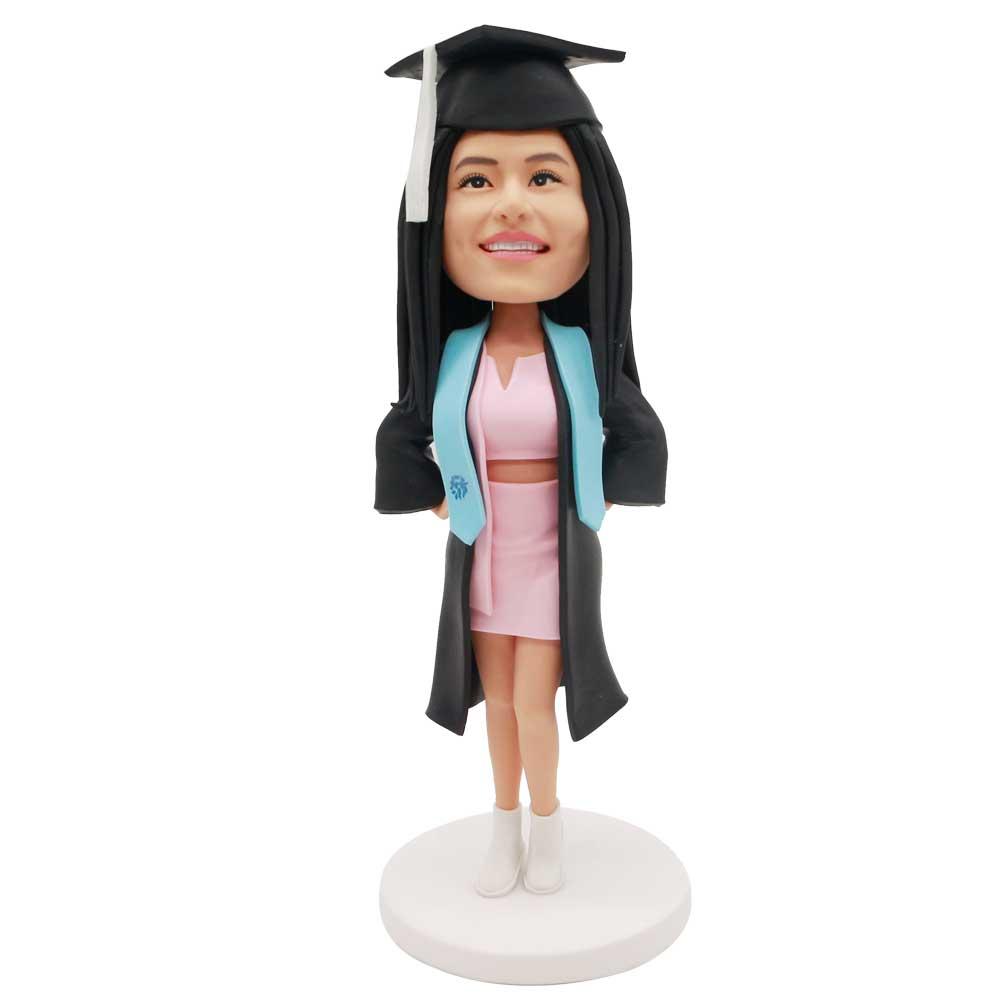 Custom-Female-Graduation-Bobblehead-In-Black-Gown-And-Pink-Skirt