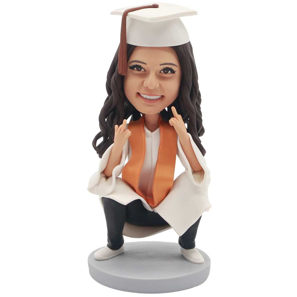 Custom-Female-Graduation-Bobblehead-In-White-Gown-And-Squat-On-The-Ground.