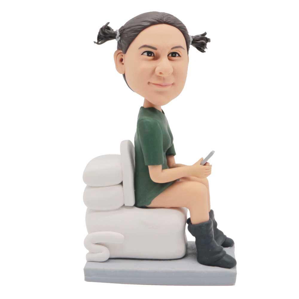 Custom-Humorous-Female-Bobblehead-In-Green-T-shirt-On-The-Toilet